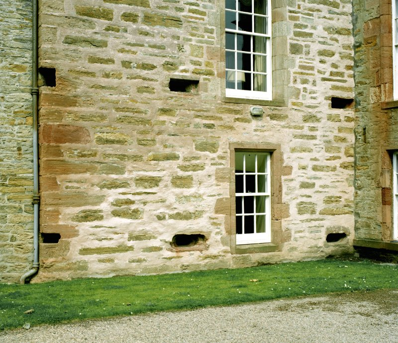 View of section of south wall of main block showing gun loops