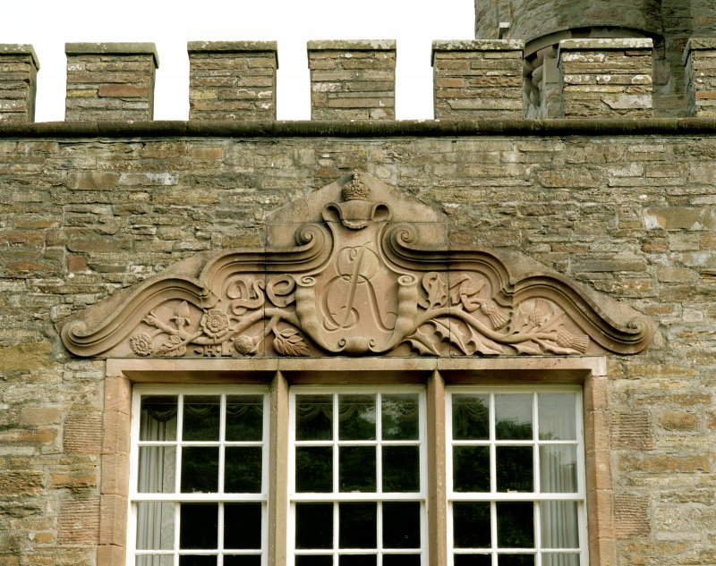 Detail of carved lintel above dining-room window on south front