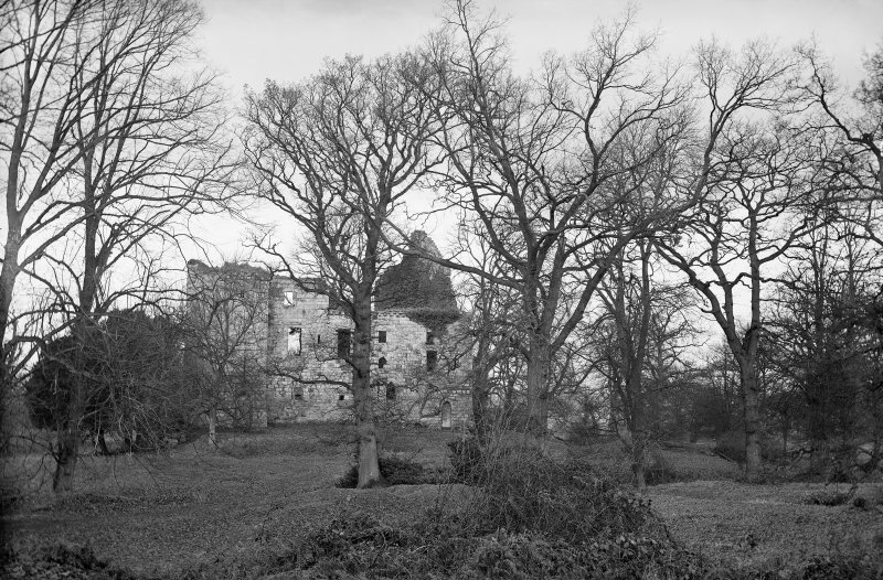 Old Tulliallan Castle. View of castle through trees. Scanned from glass plate negative. Original envelope annotated by Erskine Beveridge  'Tulliallan Cas[tle] through trees'.