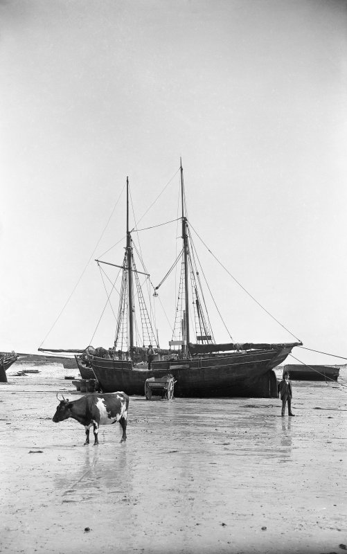 Tiree, Scarinish Harbour. General view of ship being unloaded. Scanned from glass plate negative. Original envelope annotated by Erskine Beveridge 'In Scarinish harbour 1873'