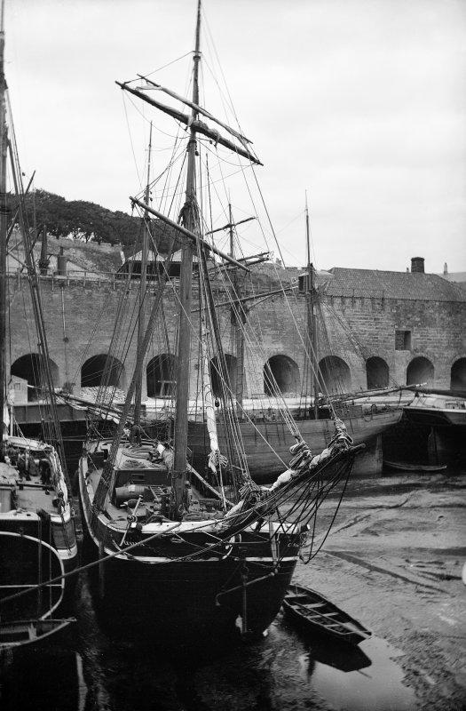 Charlestown, harbour. View of ship in harbour with limekilns in background. Scanned image from glass plate negative. Original envelope annotated by Erskine Beveridge 'Ships at Charlestown'