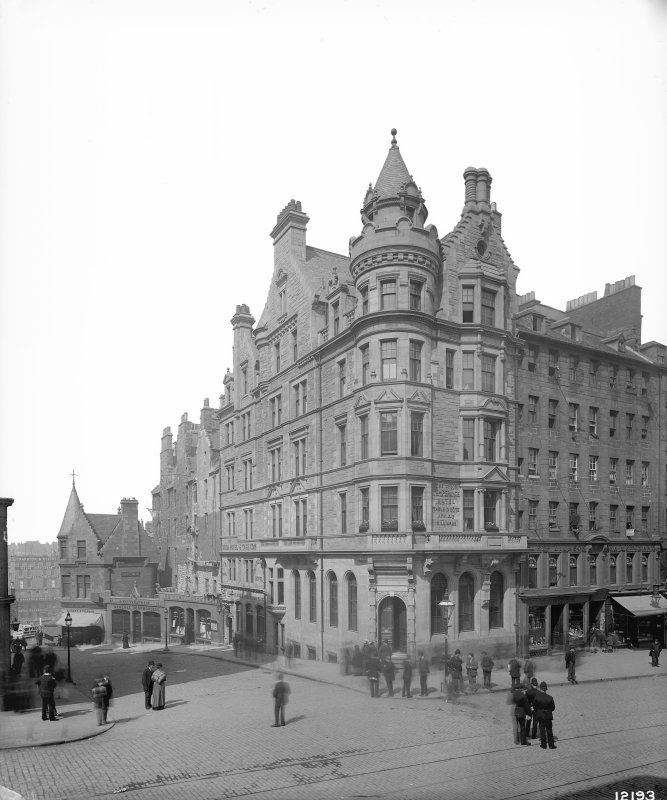 General view of bank at junction of High Street and Cockburn Street with policemen standing in middle of High Street