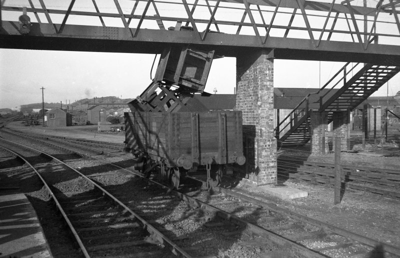 Scanned image of negative showing part of the footbridge at Rosyth Station with single wagon freight accident underneath, taken from the E.