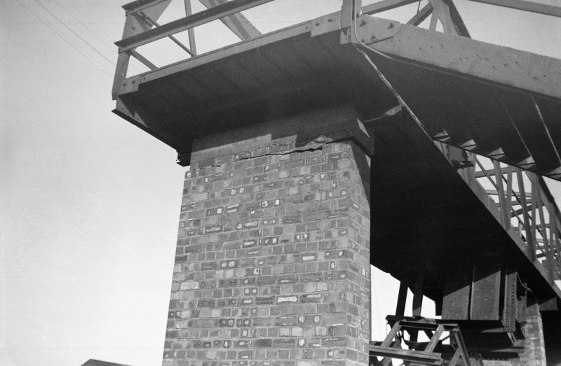 Scanned image of negative showing detail of brick footbridge pier and underside of footbridge with part of single wagon accident, taken from the SE.