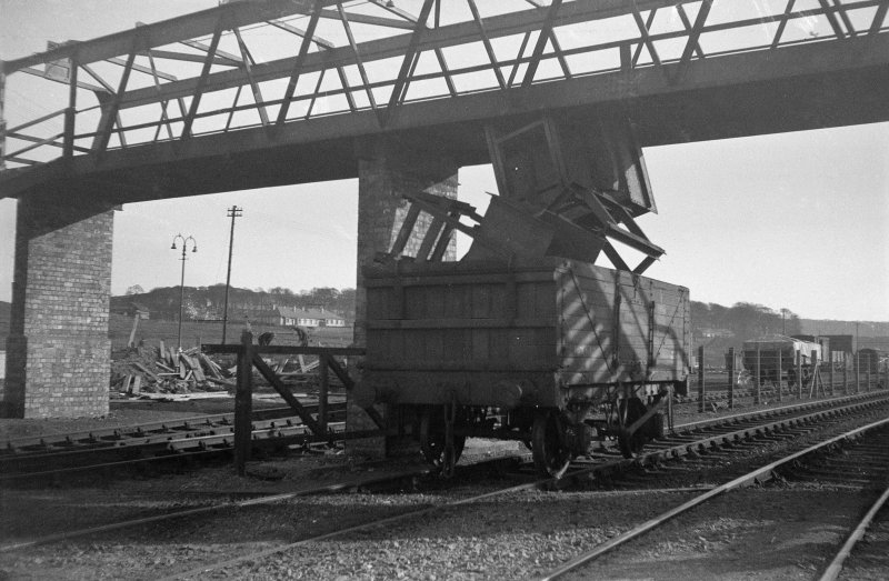Scanned image of negative showing general view of single wagon accident at W end of Rosyth Station under footbirdge, taken from NE.