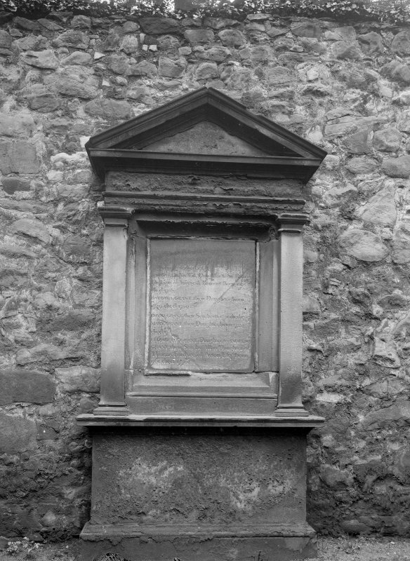 Detail of tombstone to Grants of Elchies in wall of churchyard.