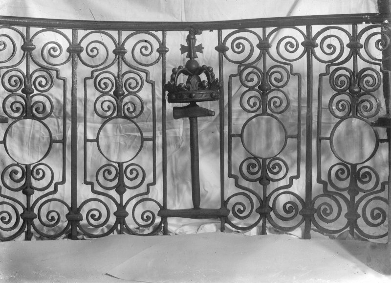 Interior-detail of wrought ironwork railing.