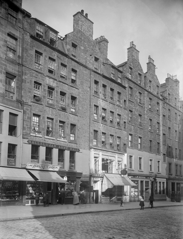 General view of Nos 341-374 High Street, Edinburgh showing the Hallelujah Army Hall, an ice and confectionary shop, the Edinburgh & Leith Equitable Sale Rooms (no.361), Tartaglia's Tea Rooms & Venetian Ice Cream Saloon (no.351) and A W Rennie spirit merchant (no.343).