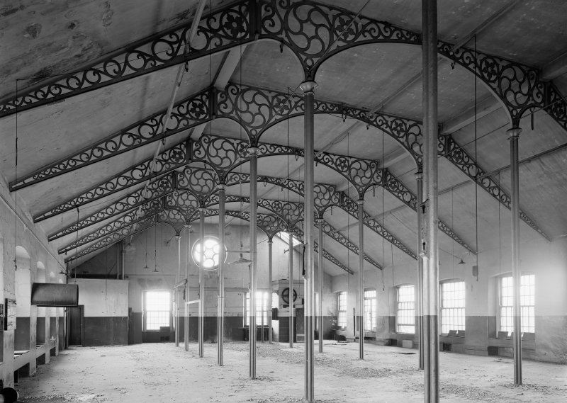 Interior view of Ward Mills, Dundee showing ornate cast iron trusses prior to demolition.