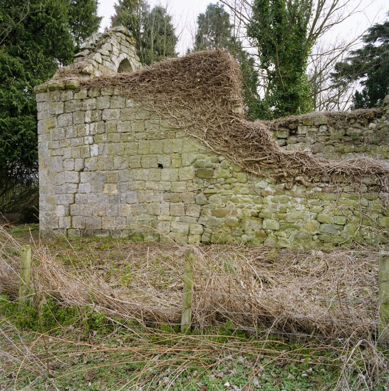 Detail of walling at E end of church from NW.