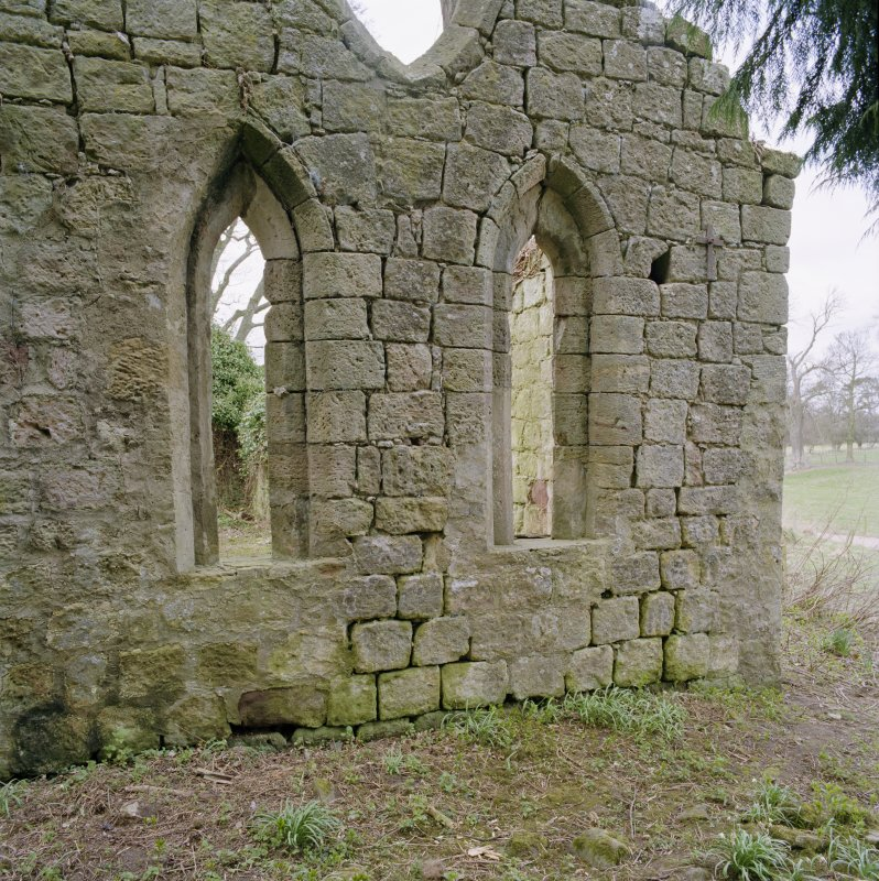 Detail of two arched windows in E gable.