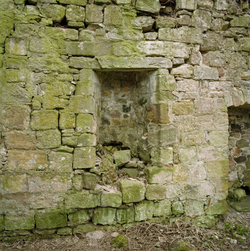 Detail of blocked opening in S wall.