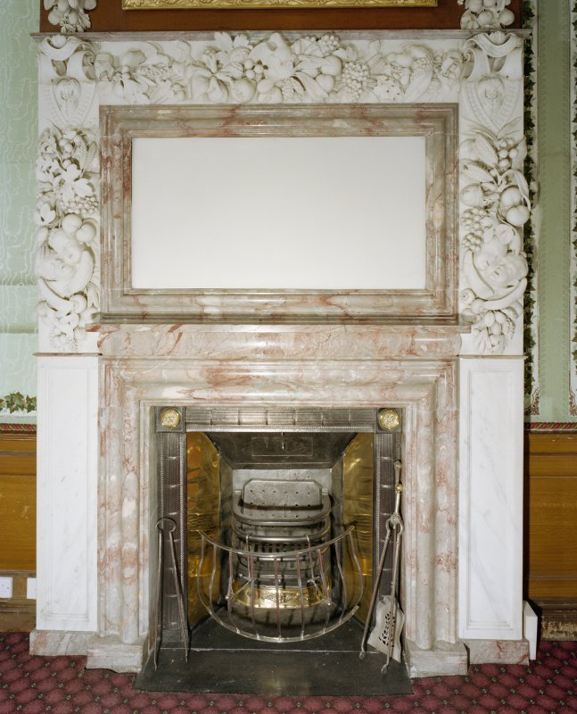 Interior, 1st. floor, room 39, detail of fireplace with decorated mirror above.
