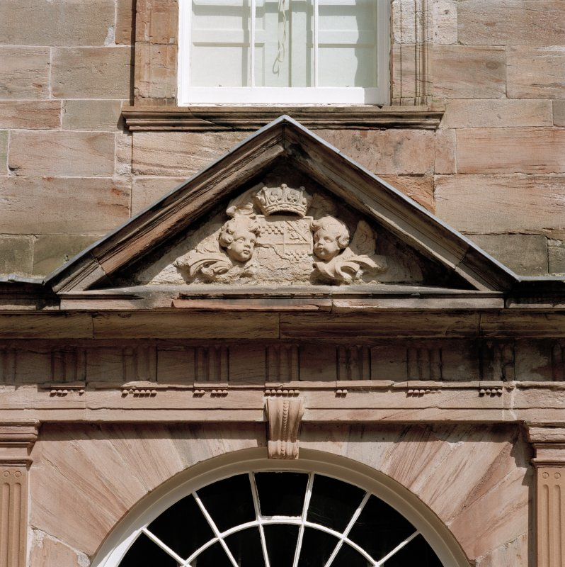 Courtyard, detail of pediment above arched window on north wall