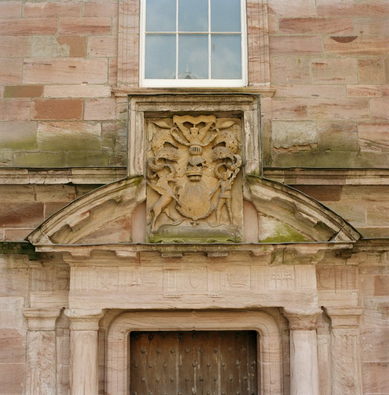 Courtyard, detail of pediment above doorway in centre of south wall