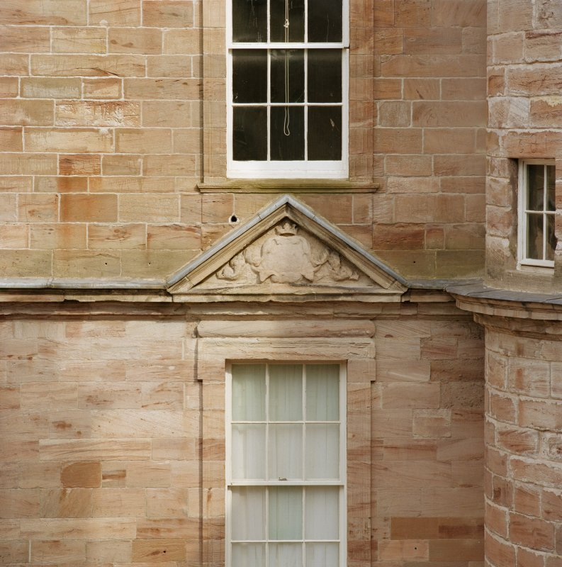 Courtyard, detail of pediment above window