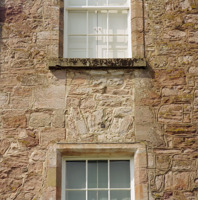 East wall of castle, detail of masonry between windows showing relieving arch