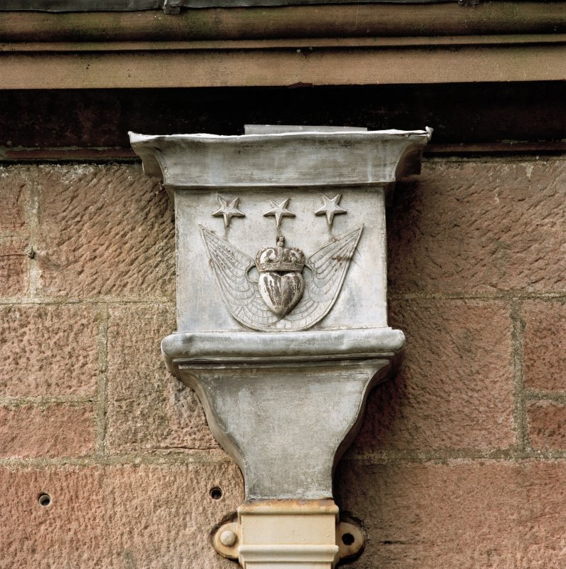 Detail of rain water head with coat of arms