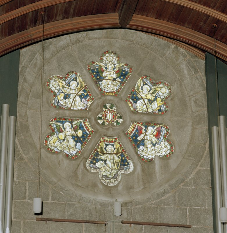 Interior view of Crathie Parish Church showing detail of the rose window in the organ loft at the West end.