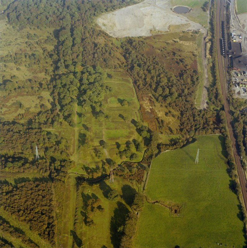 Oblique aerial view of Rough Castle Roman Fort and the Antonine wall, taken from the WSW.