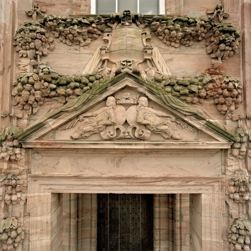 North facade, detail of tympanum with swag decoration over main entrance.