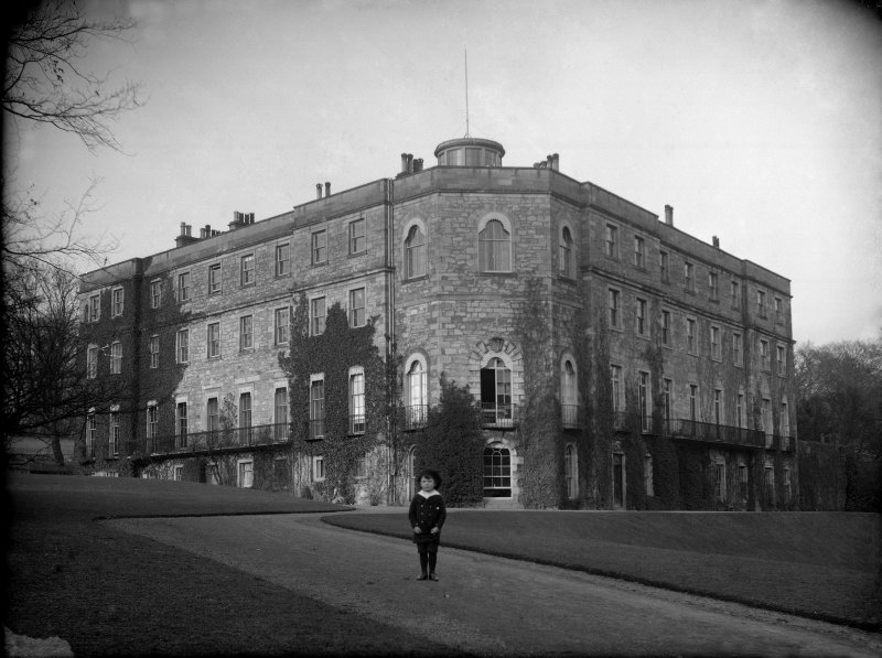 General view from SW, with child in foreground.