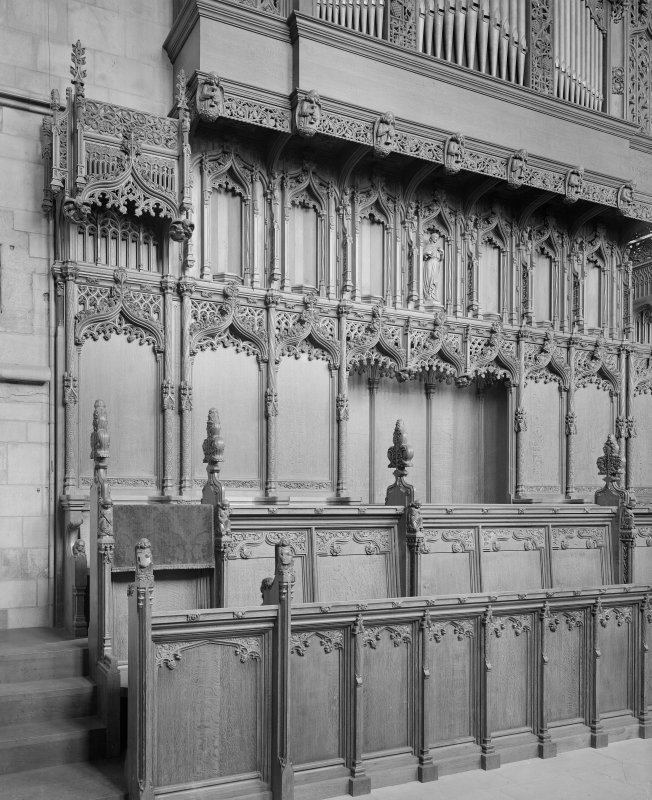 Interior-detail view of choir stalls.
