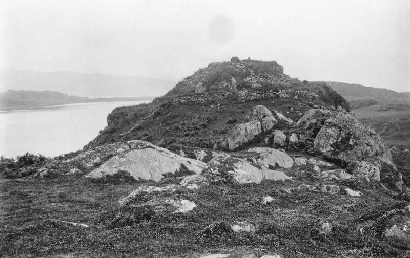 General view of dun from north. Original historic photograph mounted on card and annotated by Erskine Beveridge 'Dun Mhurich, from N. North Knapdale'.