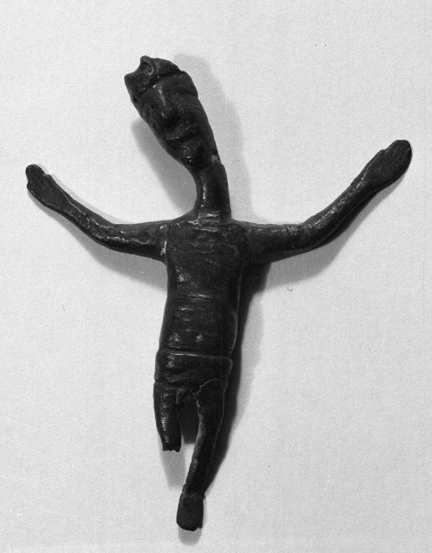 Inveraray Castle. View of the front of a bronze crucifix found during repair of Iona Cathedral, now at the castle.