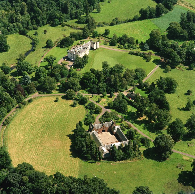 Oblique aerial view centred on the country house and stables, taken from the WNW.