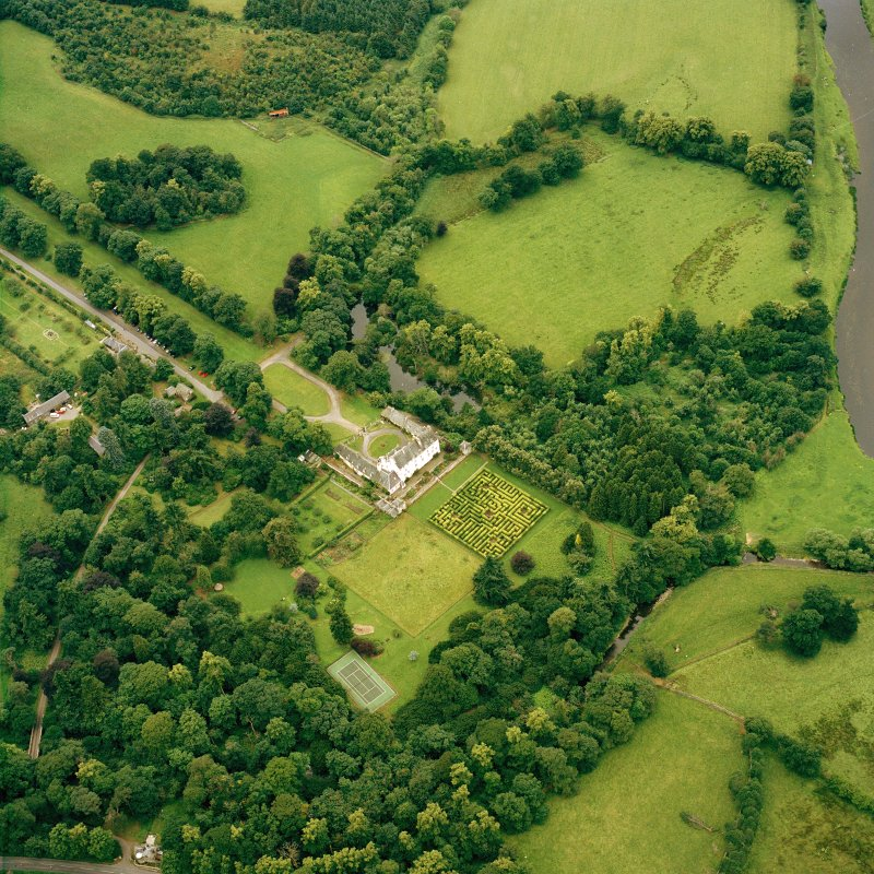 Oblique aerial view centred on the tower-house and country house with the gardens and ancillary buildings adjacent, taken from the ESE.
