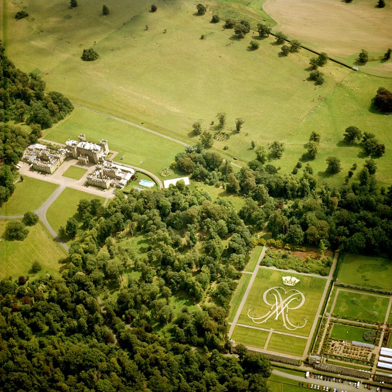 Oblique aerial view centred on the country house and formal garden.