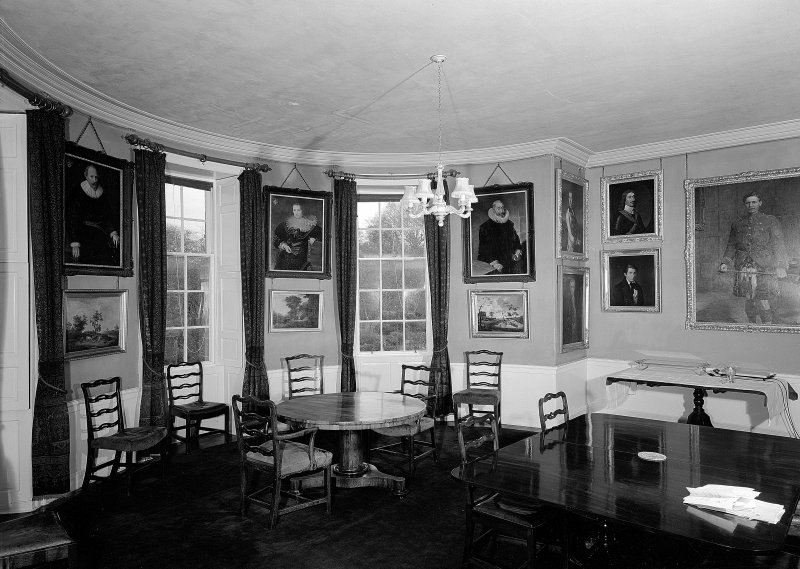 Interior. View of room with bow window.