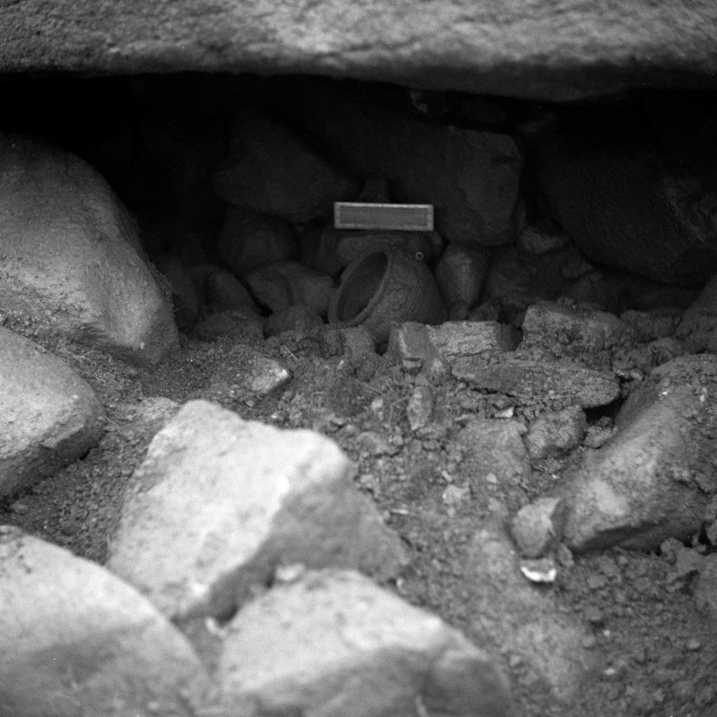 Excavation photograph showing pot find by Prof. S. Piggott