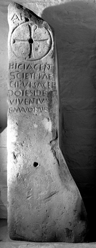 Sculptured stone (Allen and Anderson no.1), bearing Chi-Rho and inscription commemorating the priests Ides, Viventius and Mavorius.