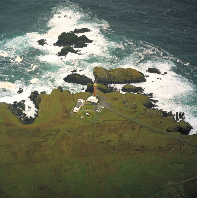 Oblique aerial view centred on the Butt of Lewis lighthouse with the remains of the enclosure adjacent, taken from the S.