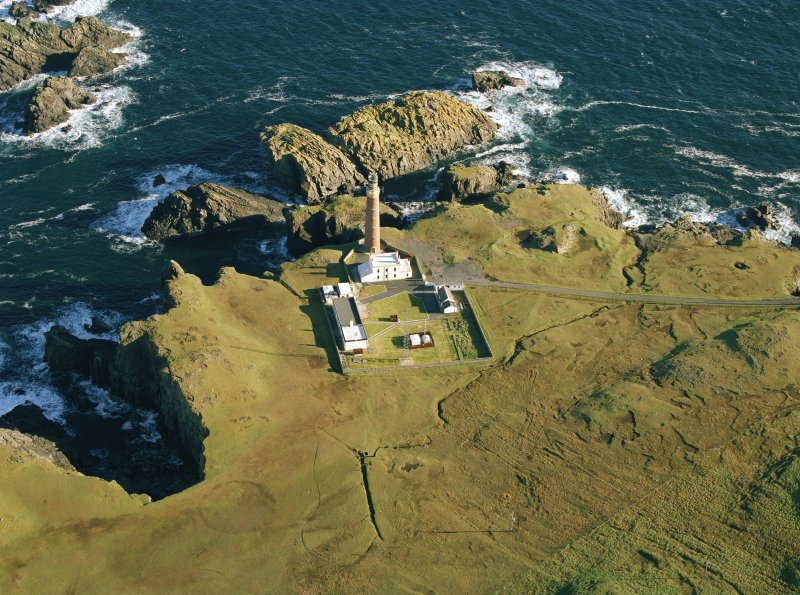 Oblique aerial view centred on the Butt of Lewis lighthouse with the enclosure adjacent, taken from the SW.