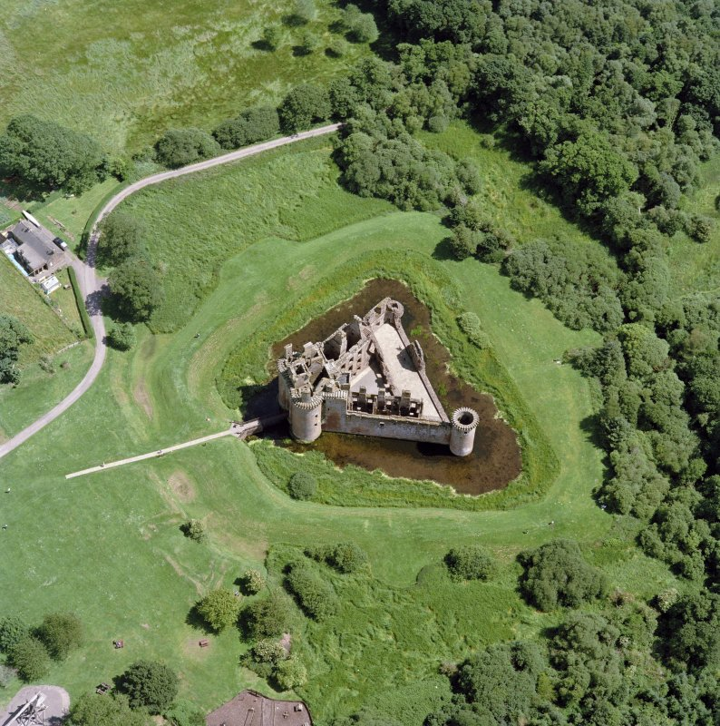 Oblique aerial view centred on the remains of Caerlaverock Castle, taken from the W.
