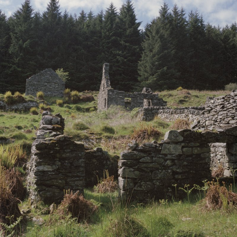 Arichonan Township. View of upper part of site from South East, showing gable of B2 and two storried house with D2 in foreground.