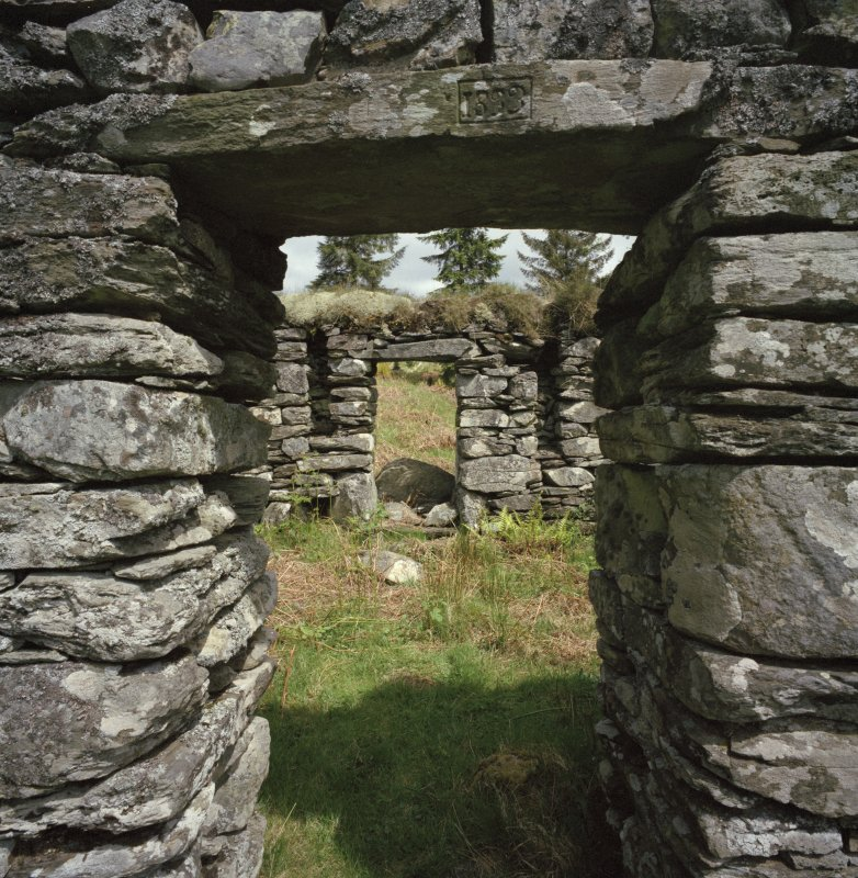 Arichonan Township. Detail of barn B2, showing cruck-slots in North wall and dated lintel.