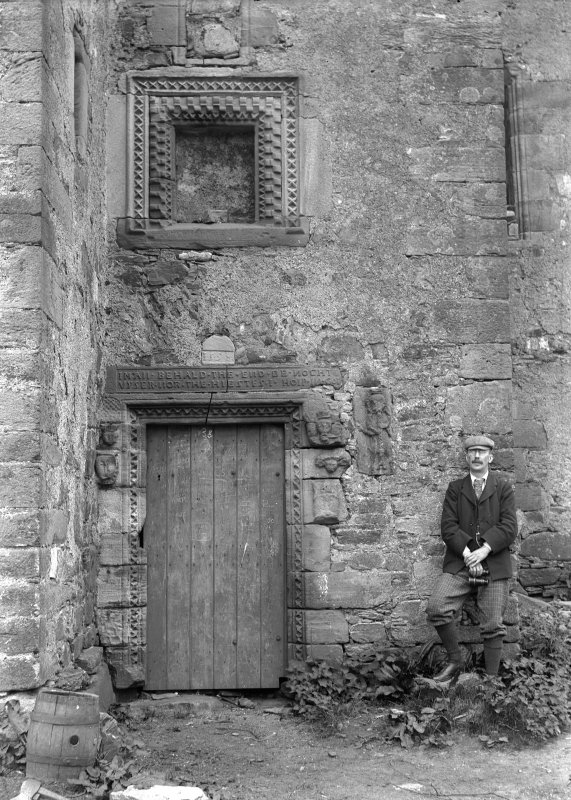View of main entrance to Dunderave Castle showing doorway and carved panel, before restoration.