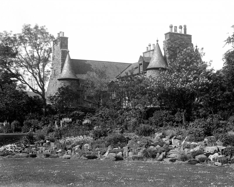 General view of Croft an Righ House from West, showing part of garden