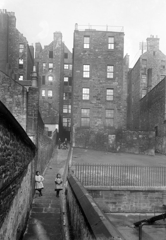 View to rear of Nos 80, 82, 84 and 86 High Street, within Dickson's Close, with children playing in Close