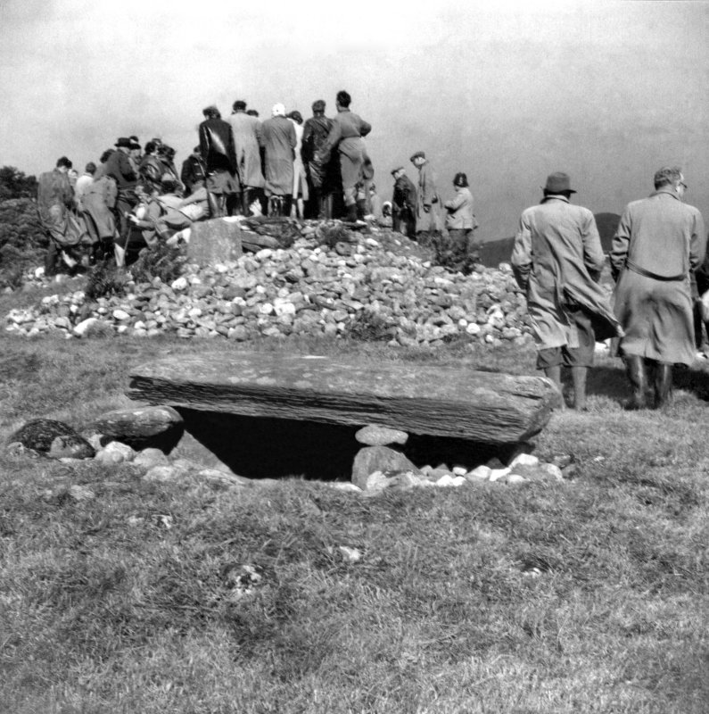 View of Nether Largie South chambered cairn with members of the Prehistoric Society Conference in 1954.