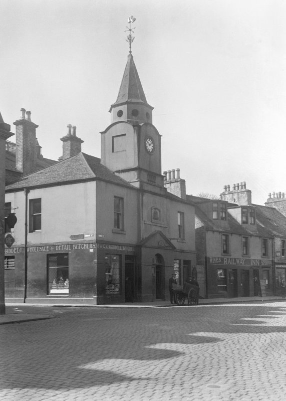 General view from NE of Stranraer Old Town Hall and a butcher shop and the Railway Inn