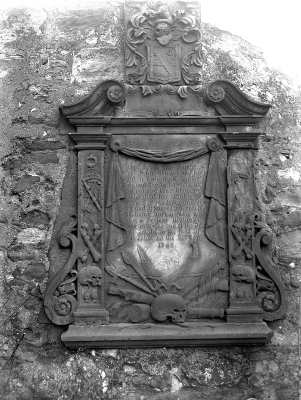 Copy of historic photograph showing detail of gravestone.