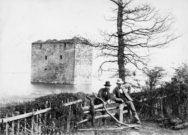 View of castle with men leaning on fence in foreground Titled: 'Stanely Castle.' Inscribed on verso: 'Residence of the Ross family, now in reservoir at Nethercraig.'
