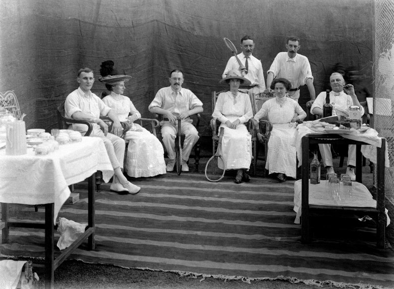 Seated group with tennis racquets.  Unknown location, probably Kolkata.