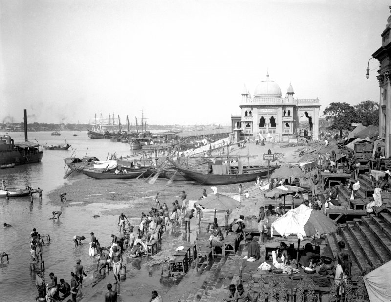 Riverside scene with bathers, looking north from Chatulal's Ghat towards Ram Chandra Goenka's Zenana (ladies) ghat, Kolkata.