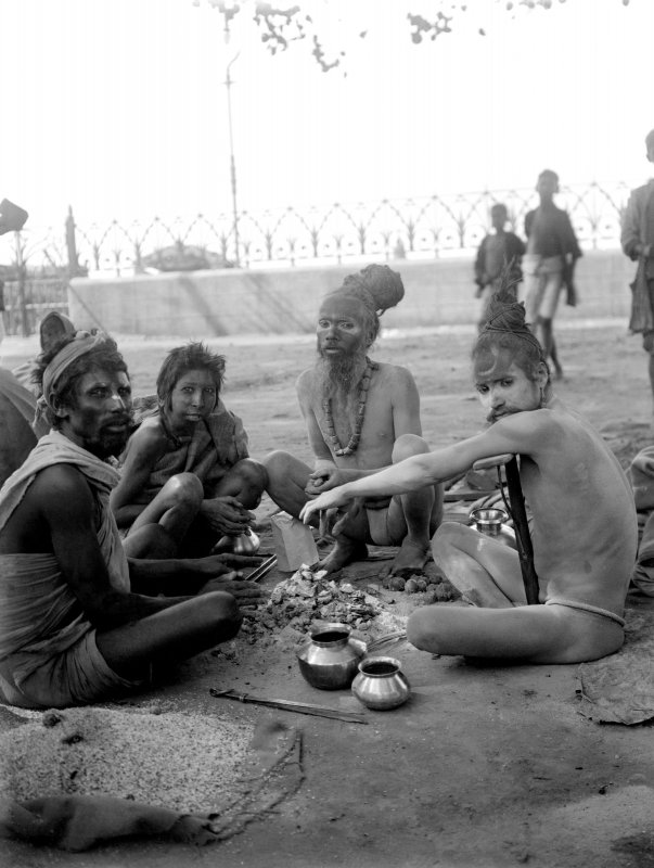 Ascetics or sadhus seated, possibly near Chandpal Ghat, Kolkata.